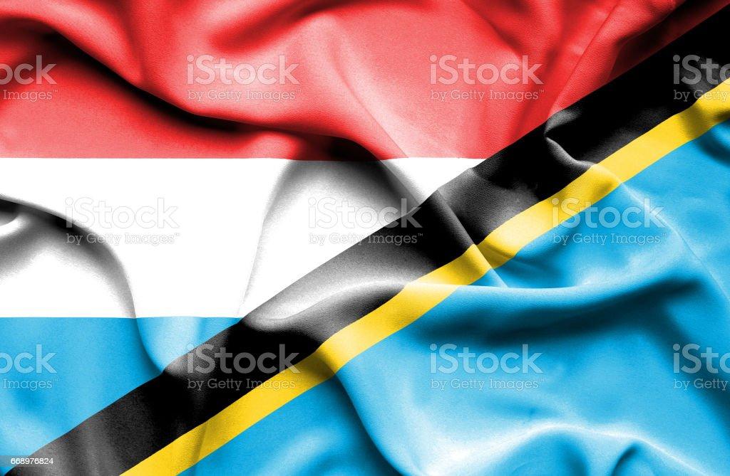 Waving flag of Tanzania and Luxembourg waving flag of tanzania and luxembourg - immagini vettoriali stock e altre immagini di accordo d'intesa royalty-free