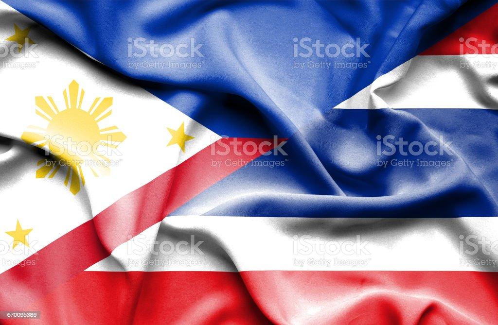 タイとフィリピンの旗を振っています。 ベクターアートイラスト