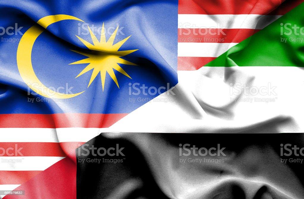 Waving flag of United Arab Emirates and Malaysia waving flag of united arab emirates and malaysia - immagini vettoriali stock e altre immagini di accordo d'intesa royalty-free