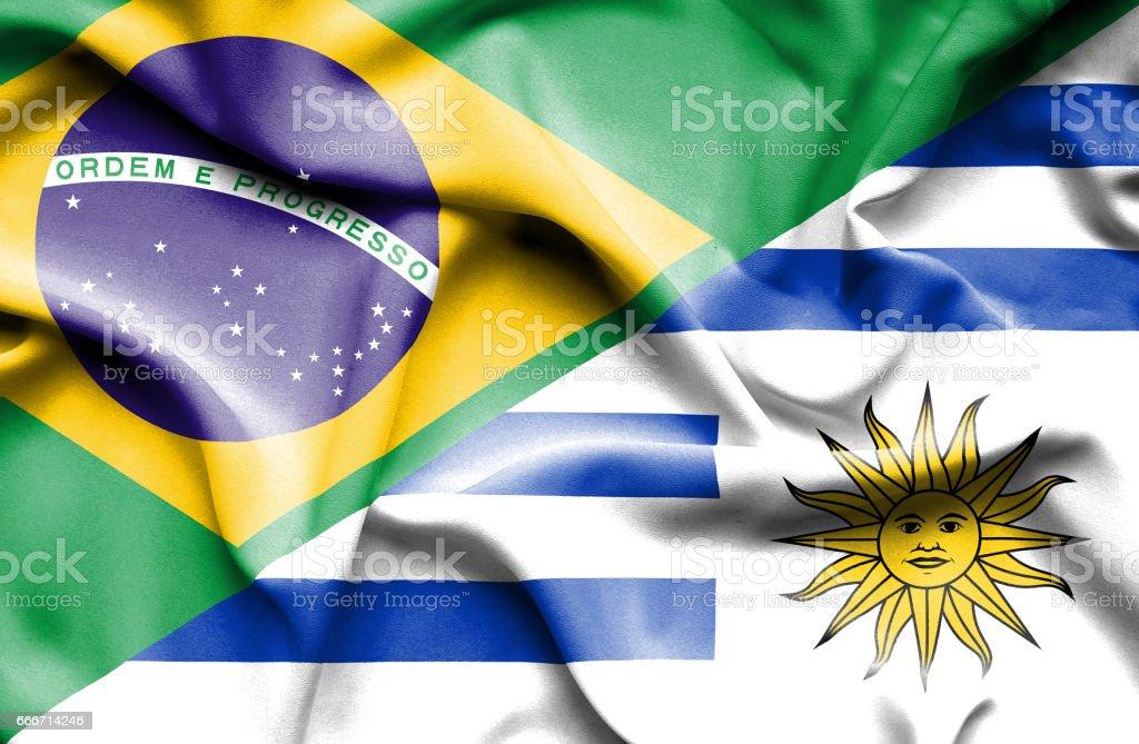 Waving flag of Uruguay and Brazil - ilustración de arte vectorial