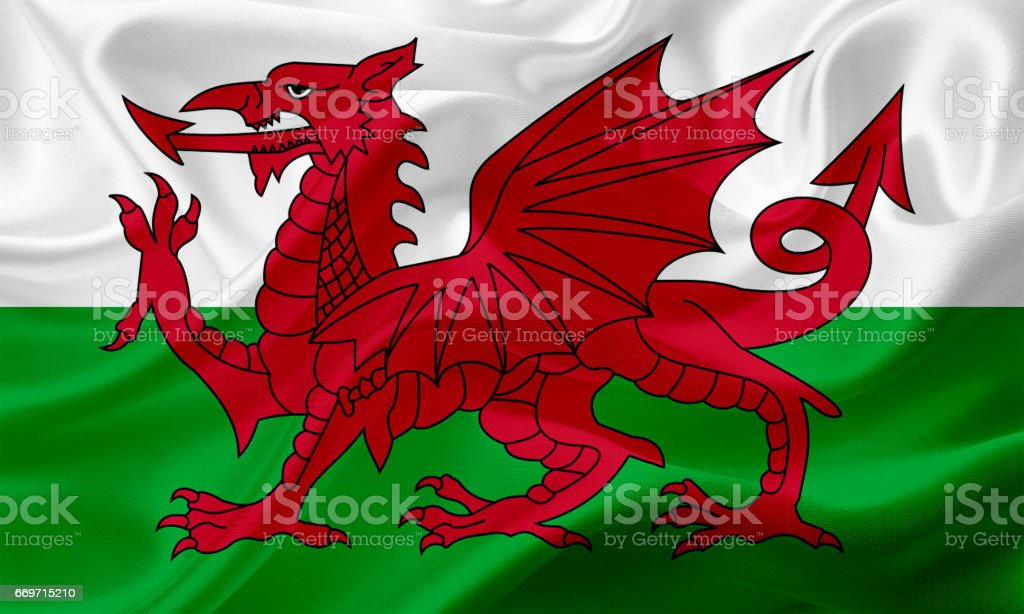 Waving flag of Wales with fabric texture vector art illustration