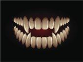 White predatory teeth on a black background