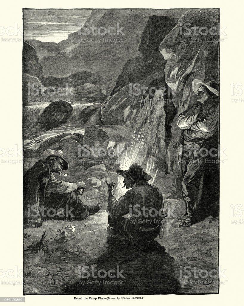 Wild west cowboys sat round a campfire, 19th Century vector art illustration