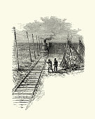 Vintage engraving of Wild west railroad, steam train passing native american wigwam, USA, 19th Century