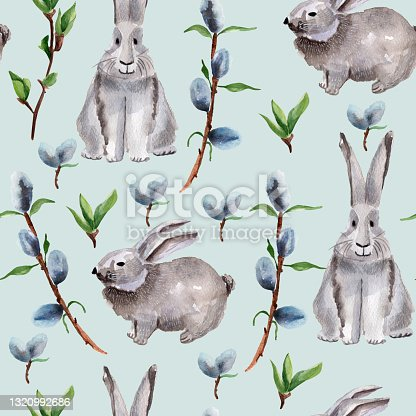 istock Willow twigs and hares on a blue background watercolor seamless pattern 1320992686