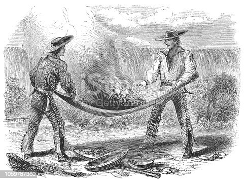 Winnowing for gold in California, United States of America (circa mid 19th century). Vintage etching circa mid 19th century.
