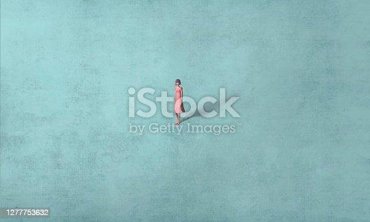 istock Woman alone in blue 1277753632
