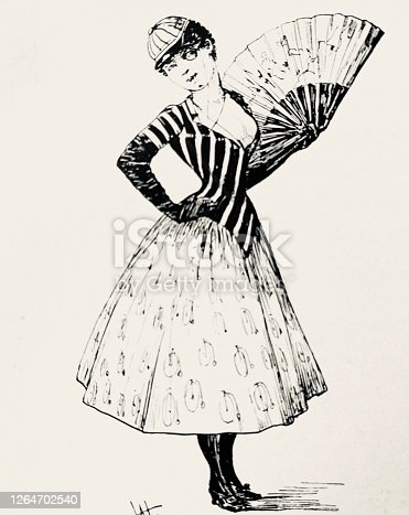 istock Woman holding a fan, flirting, penny farthing bicycle prints on her dress, wide neckline of the sweater 1264702540