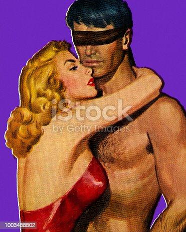 istock Woman Hugging Blindfolded Man 1003488802