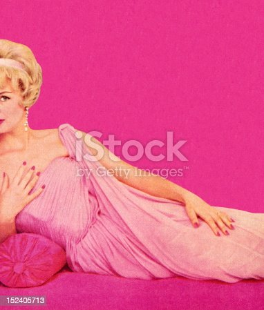 istock Woman in Pink Dress Reclining 152405713