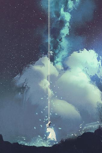 woman on a swing under night sky