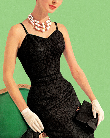 Woman wearing black dress and pearl necklace