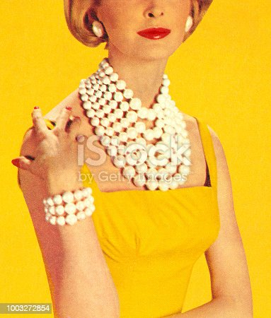 Woman Wearing Jewelry and a Yellow Dress