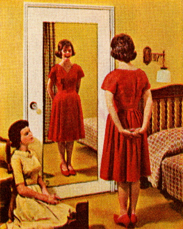 Woman Wearing Red Dress in Front of Mirror