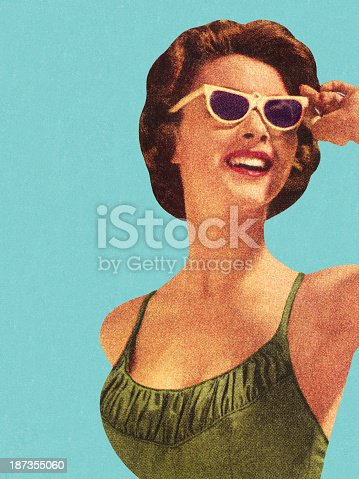 istock Woman Wearing Sunglasses and Green Swimsuit 187355060