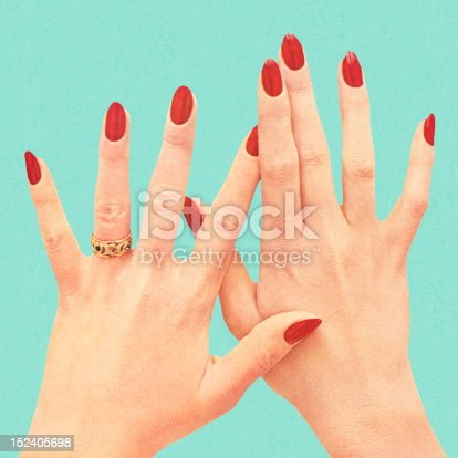 Women's Hands With Red Polish