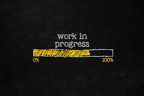 Work in progress loading bar Progress loading concept with copyspace for website, user interfaces, installation software, preloading webpage, work in progress. A loading bar isolated on blackboard indicate a percentage. incomplete stock illustrations