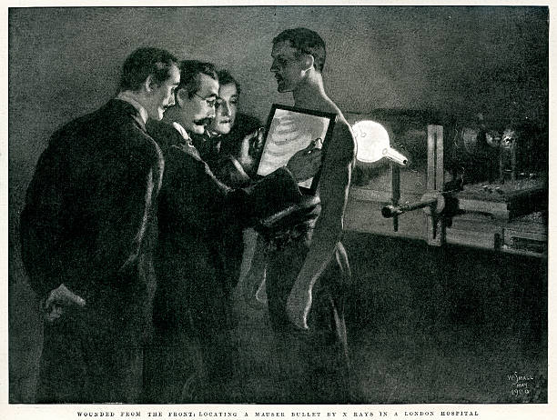 X-Ray's of a Wounded Solider Vintage engraving of a scene from the Boer War, wounded from the front, locating a Mauser bullet be X-Ray in a London Hospital. The Graphic, 1900 edwardian style stock illustrations