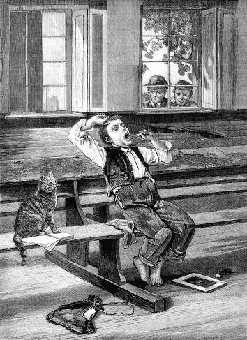 Yawning boy in a schoolroom