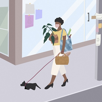 Young beautiful women take the dog for a walk and shopping.