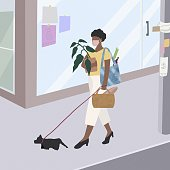 istock Young beautiful women take the dog for a walk and shopping. 1254768630