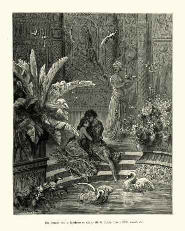 Young couple in love, embracing in a secret garden, Medieval romance