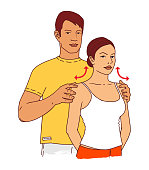 Young man doing a girl's massage of the shoulder girdle and neck