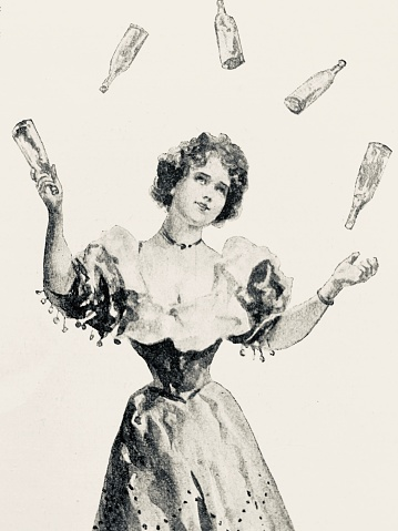 Young woman juggling bottles