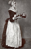Young woman serving the coffee