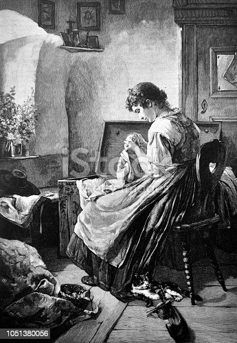 Young woman stitches a beautiful pattern on a decorative scarf - 1888