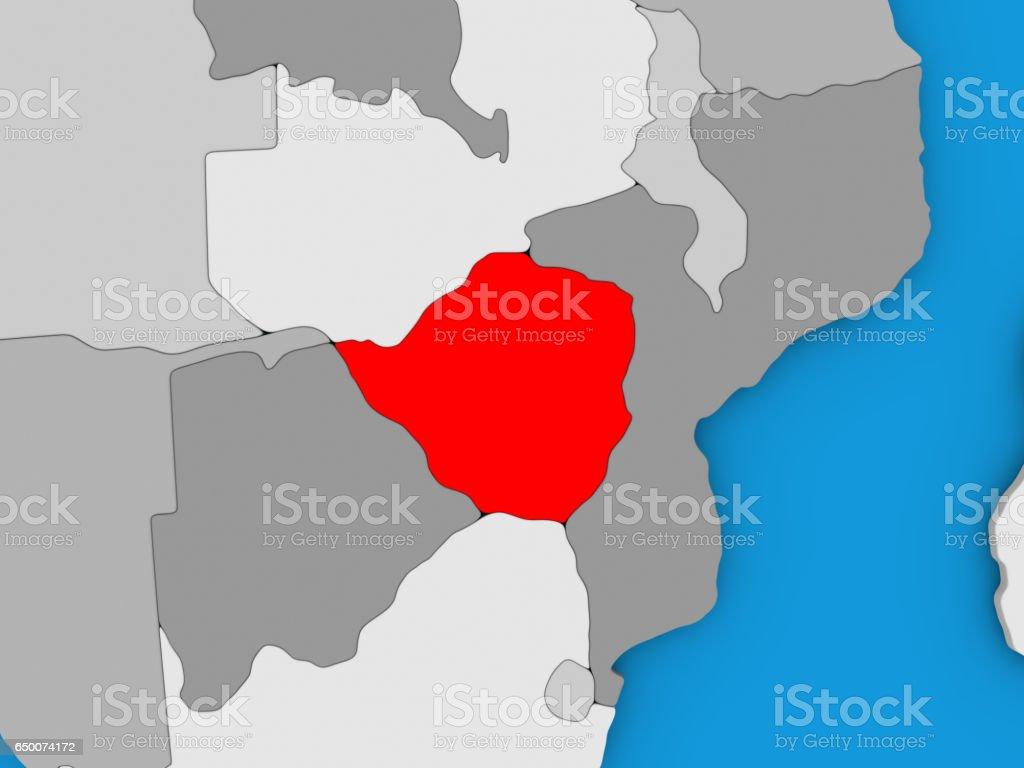 Zimbabwe in red on globe vector art illustration