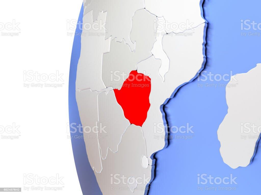 Zimbabwe on metallic globe vector art illustration