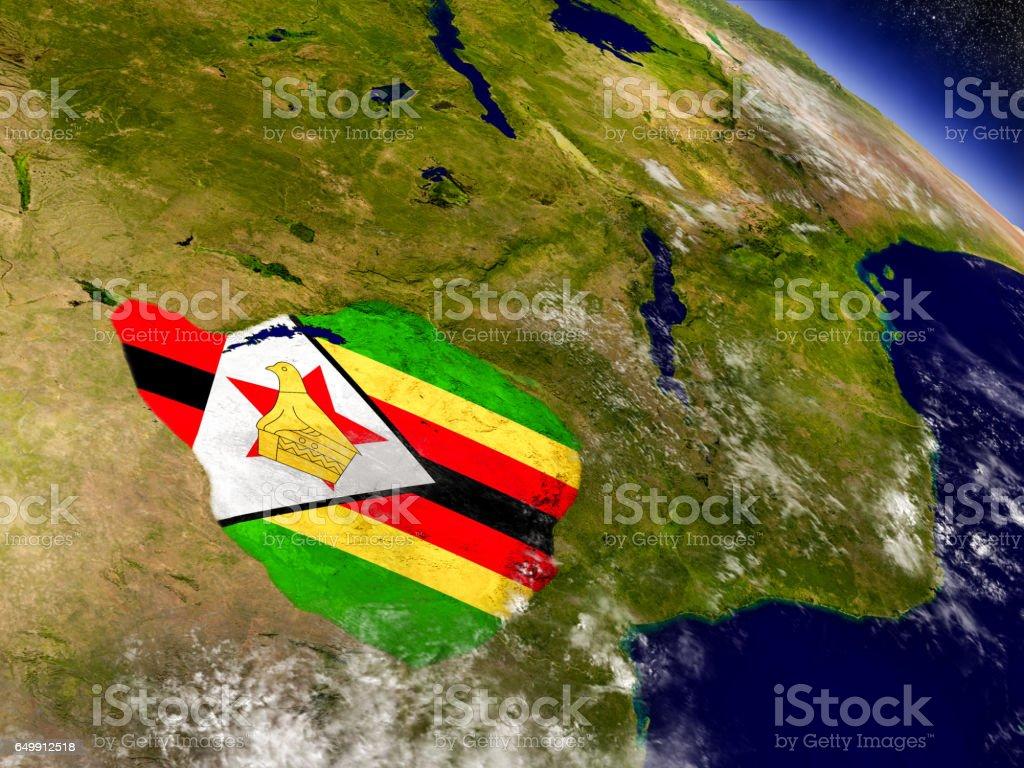 Zimbabwe with embedded flag on Earth vector art illustration