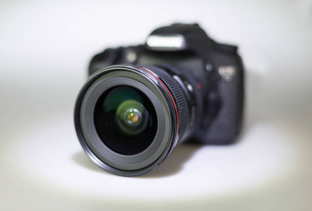 DSLR isolated DSLR with wide-angle lens digital single lens reflex camera stock pictures, royalty-free photos & images