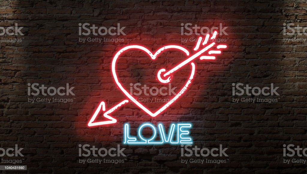 HEART SYMBOL AND ARROW NEON SIGN ON A BRICK NIGHT WALL LOVE DARK GLOW stock photo