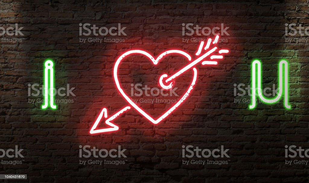 I LOVE YOU NEON SIGN WITH HEART AND ARROW SYMBOL ON A BRICK WALL GLOWING stock photo