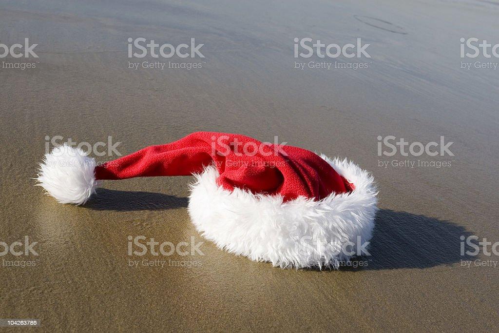 SANTA HAT ON THE BEACH royalty-free stock photo