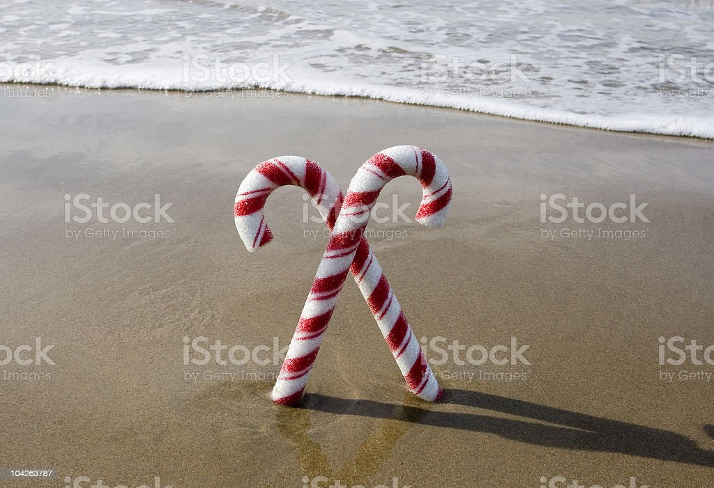 CANDY CANES AT THE BEACH stock photo