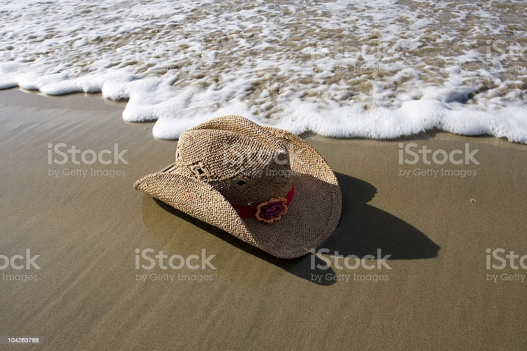 COWGIRL HAT ON SHORE royalty-free stock photo