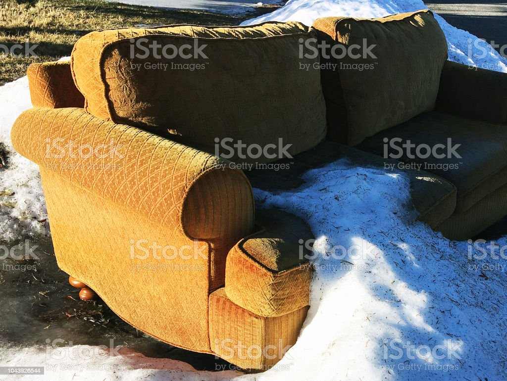 SOFA IN SNOWBANK stock photo