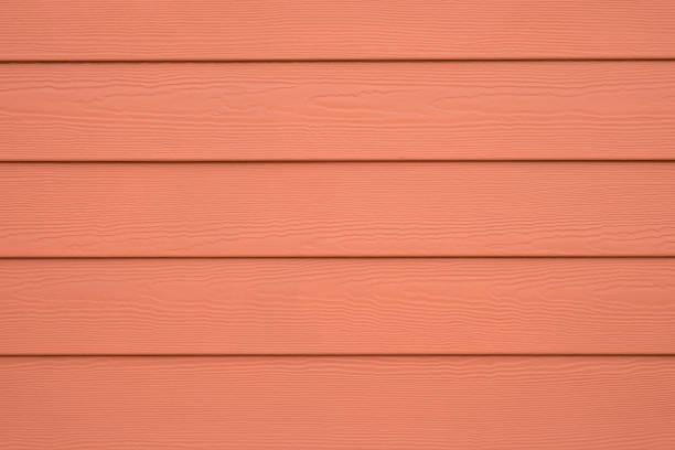 substitut de bois mur bardage pour toile de fond, couleur orange - fibre photos et images de collection