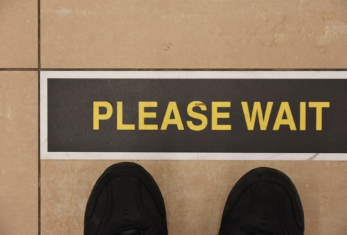 Please Wait Sign Stock Photo - Download Image Now
