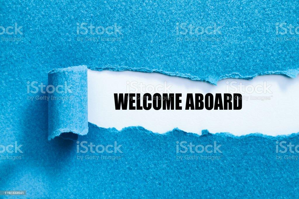 WELCOME ABOARD WELCOME ABOARD written under torn paper. Aboard Stock Photo