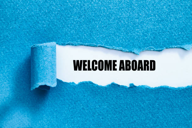 WELCOME ABOARD WELCOME ABOARD written under torn paper. aboard stock pictures, royalty-free photos & images