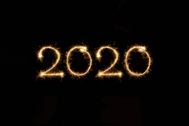 2020 2020 written with sparklers jude beck stock pictures, royalty-free photos & images