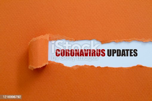 CORONAVIRUS UPDATES message written under torn paper