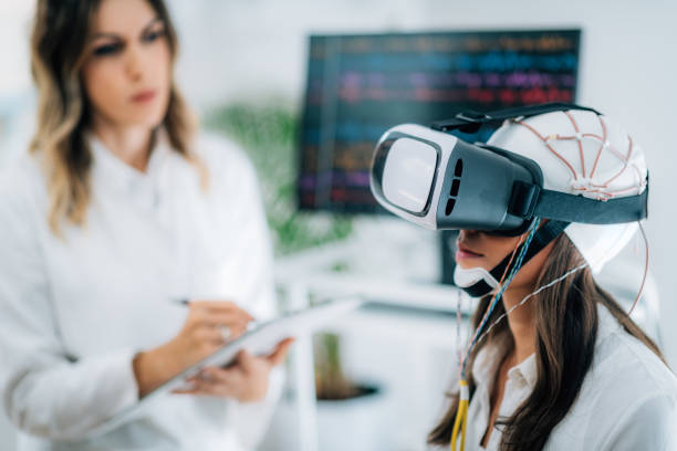 VR EEG Neuroscience Lab. Patient with Virtual Reality Goggles and EEG Brainwave Cap neuroscience patient stock pictures, royalty-free photos & images