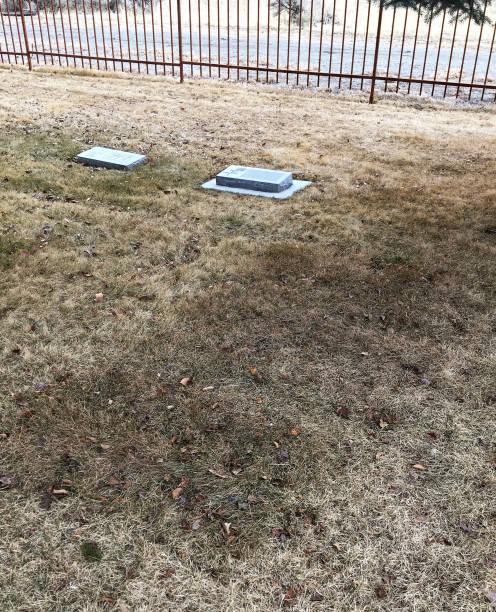 BURIAL PLOT MARK IN GRASS stock photo