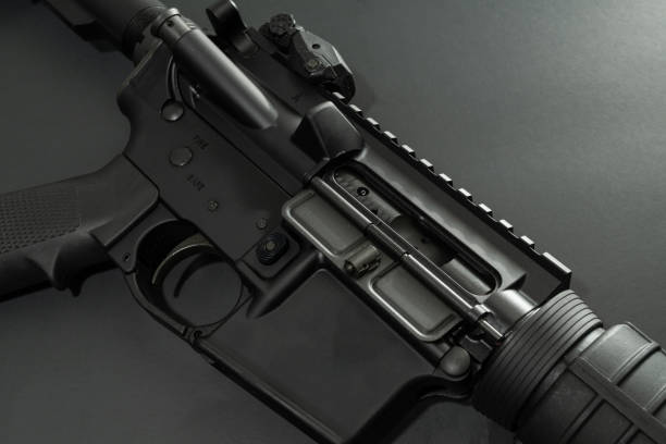 AR - 15 Black AR-15 laying on black background. ar 15 stock pictures, royalty-free photos & images