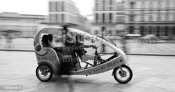 Milan, Italy - August 28, 2020:Elettric taxi for tourist's shopping in center of Milan